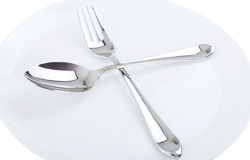 Dinner plate, spoon and fork. Stock Photography