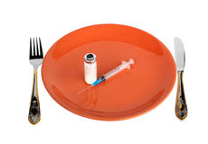 Dinner Plate With Syringe and Medication. Fork and knife. Isolated Royalty Free Stock Photos