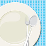Dinner plate 2. Vector illustration of a laid table with an empty plate and checkered tablecloth Royalty Free Stock Photo