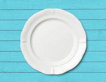 Dinner plate on wood table Royalty Free Stock Photo