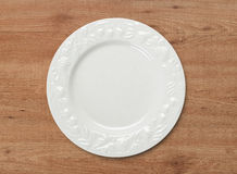 Dinner plate on wood table Royalty Free Stock Images