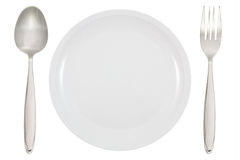 Dinner Plate, wooden fork and spoon Royalty Free Stock Photography