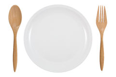Dinner Plate, wooden fork and spoon Royalty Free Stock Images