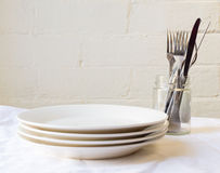 Dinner plates and cutlery Stock Images