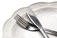 Dinner plates with knife and fork Stock Photos