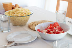 Dinner plates - pasta and salad Royalty Free Stock Image