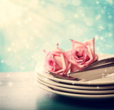 Dinner plates with pink roses Royalty Free Stock Photos