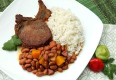 Dinner. Pork chop with rice and beans Stock Photography