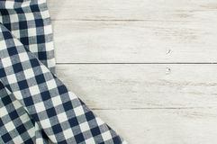Dinner preparation. Checkered tablecloth on wooden table Stock Images