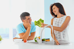 Dinner preparation. Loving couple washing vegetables. Stock Photography