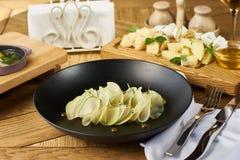 Dinner in restaurant Stock Images