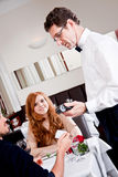Dinner in restaurant man and woman pay by credit card Stock Photo