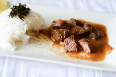 Dinner with rice and beef stew Stock Photography