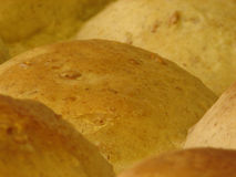 Dinner roll up close. Freshly baked, lightly browned dinner roll hot out of the oven Stock Images