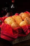 Dinner Rolls with Oil and Wine. An elegant setting of dinner breads in a woven basket lined with a luxuriously red cloth. Bottles of oil and wine and a full royalty free stock photography