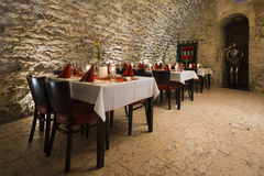 Dinner at romantic arch stonewall in knight room Stock Photo