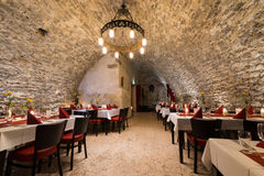 Dinner at romantic arch stonewall in knight room Stock Photos