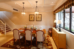 Dinner Room. The luxury dinner room in a modern house royalty free stock image