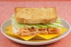 Dinner sandwich. Delicious fresh sandwich made with fine meats cheese and green apple Royalty Free Stock Photo