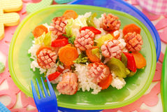 Dinner with sausage,vegetables and rice for child Stock Images