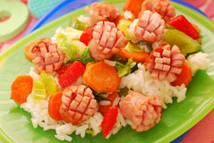 Dinner with sausage,vegetables and rice for child Stock Image