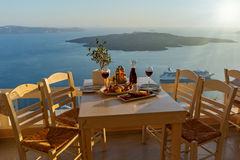 Dinner with seafood and red wine. On the background of sea sunset stock images