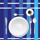 Dinner service on a blue tablecloth Royalty Free Stock Photo