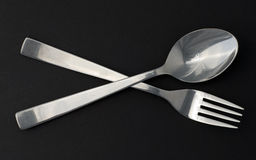 Dinner set. Isolated dinner set spoon and fork Royalty Free Stock Photography