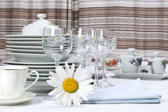 Dinner set  and camomile. Close-up Stock Photo
