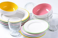Dinner set. Consisting of deep bowls, dinner plates, side plates and glasses Stock Photos