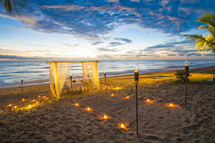 Dinner set up on the beach sunset time. Dinner set up on the beach, romantic Royalty Free Stock Image