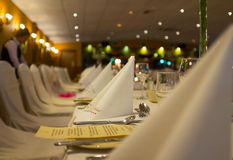 Dinner set up in the luxury restaurant.  Royalty Free Stock Images