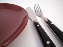 Dinner setting 1. Plate, knife and fork royalty free stock photography