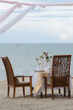 Dinner setting on the beach Royalty Free Stock Image