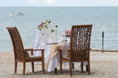 Dinner setting on the beach Royalty Free Stock Images