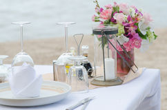 Dinner setting on the beach Stock Images
