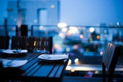 Dinner setting. With night and light of skyscraper view ,bangkok, thailand Stock Image