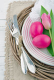 Dinner setting with two pink easter eggs and tulip Royalty Free Stock Photography
