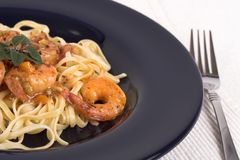 Dinner with shrimp. Shrimp and pasta dinner royalty free stock photos
