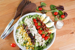 Dinner sized cobb salad. Dinner sized entree serving of cobb salad garnished with leaf lettuce and ranch dressing stock photography