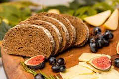 Dinner still life with rye bread, cheese and figs Royalty Free Stock Images