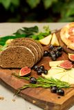 Dinner still life with rye bread, cheese and figs Stock Photos
