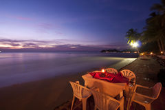 Dinner on sunset at beach in Thailand Stock Photo