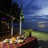 Dinner on sunset at beach in Thailand Royalty Free Stock Images