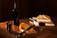 Dinner in a sunset mood. ( rustic wine, bread cheese, pepper, salt Stock Image