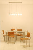 Dinner table. Under group of drop lamp stock photos
