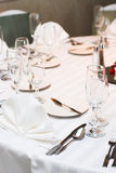 Dinner table. Is all set and ready for guests in a wedding ceremony stock images