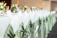 Dinner table. Is all set and ready for guests in a wedding ceremony stock photography