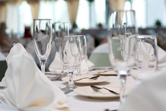 Dinner table. Is all set and ready for guests in a wedding ceremony royalty free stock image