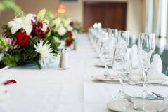 Dinner table. Is all set and ready for guests in a wedding ceremony stock photo